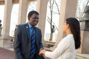 President with student in the colonnade.